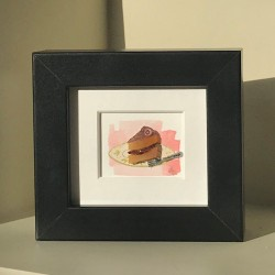 Miniature Slice Of Cake In A Black Frame