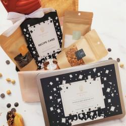 Dark chocolate and praline madeleines kit in a gift box