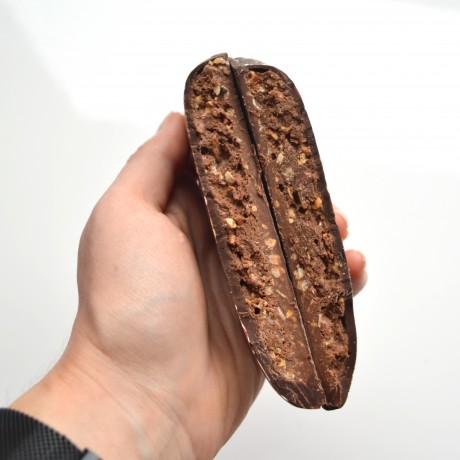 Chocolate herart is broken to be shared between 2 person