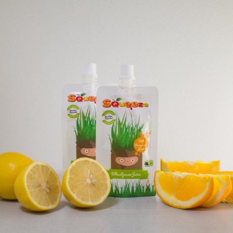 Squeeze Wheatgrass Shots with Orange and Lemon Juice