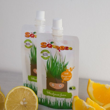 Wheatgrass Shots with Orange and Lemon Juice