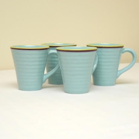 Hand painted four piece mug set