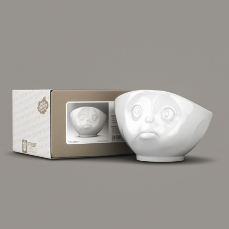 A white porcelain bowl with a sulking expression with its gift box