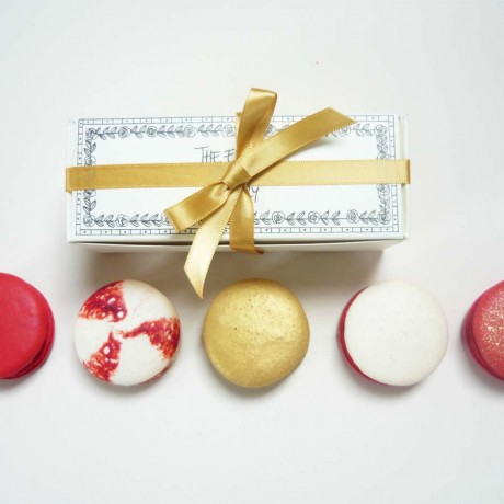 gold and red macarons