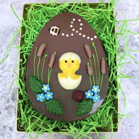 Large Flat Milk Chocolate Easter Egg Decorated with Rabbits and Flowers